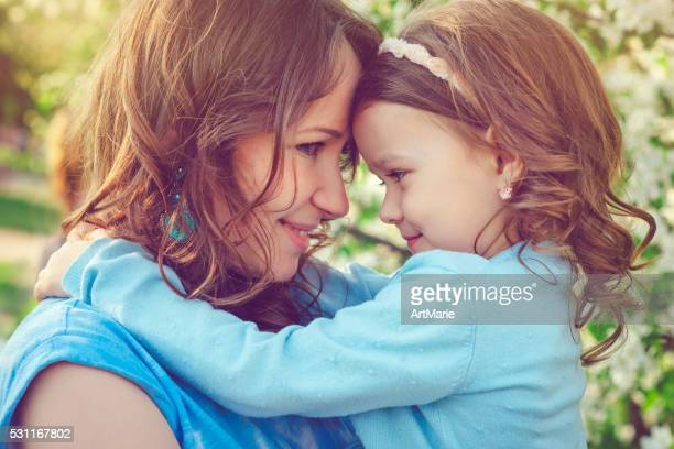 Mother and daughter in spring