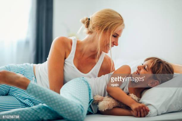 Mother and Daughter in the bed