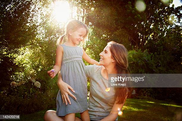 Mother and daughter (4 - 5 years) in the garden