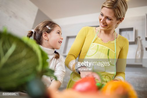 Mother and daughter in the kitchen. : Stock Photo