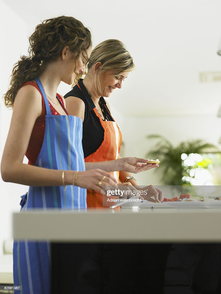 Mother and daughter in the kitchen : Stock Photo