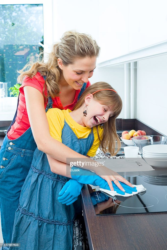 Mother And Daughter In The Kitchen Together : Stock Photo