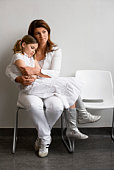 Mother and daughter in waiting room