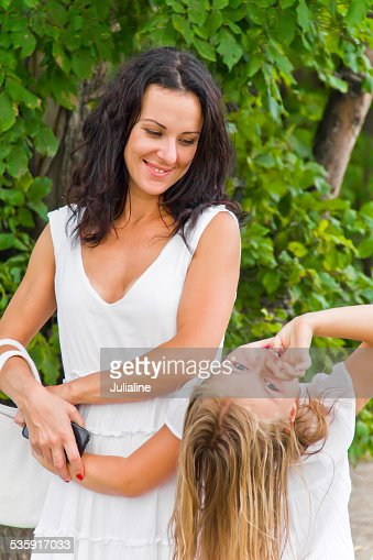 Mother and daughter in white : Stock Photo