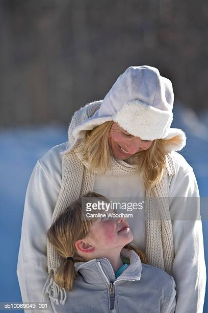 Mother and daughter (8-9) in winter clothes, outdoors