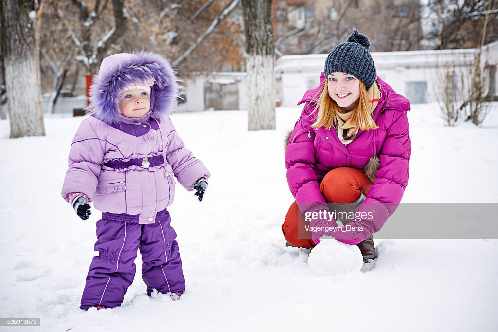 Mother and daughter in winter park : Stock Photo