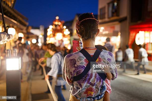 Mother and daughter is on street at Narita Gion Festival