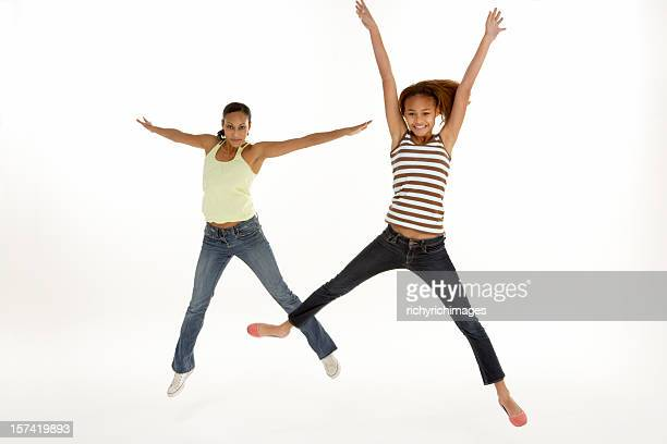 Mother And Daughter Leaping In Air