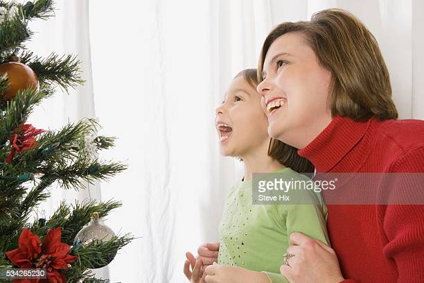 Mother and Daughter Looking at a Christmas Tree
