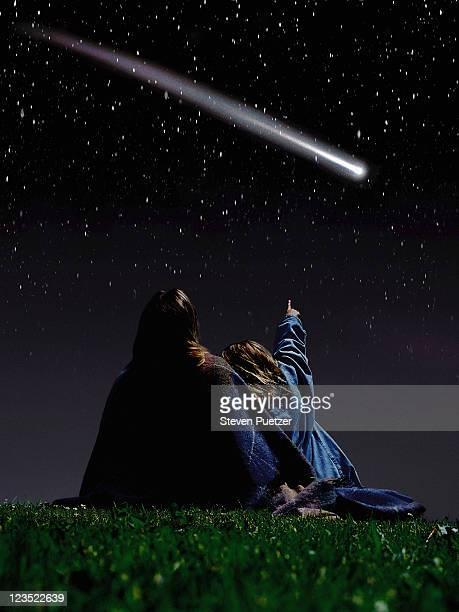 Mother and daughter looking at a comet