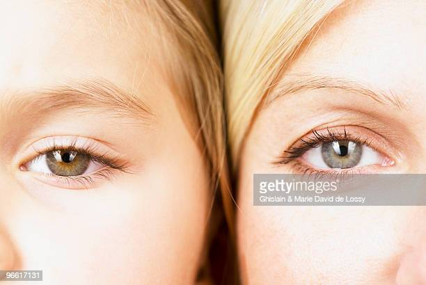 Mother and daughter looking at camera