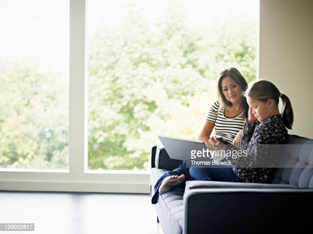 Mother and daughter looking at digital tablet