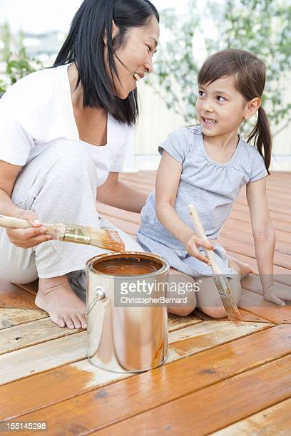 Mother and daughter looking at each other while painting
