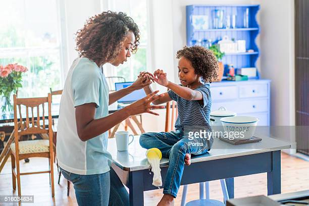 Mother and daughter looking at food spilling from glass