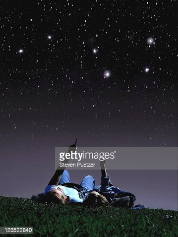 Mother and daughter looking at stars
