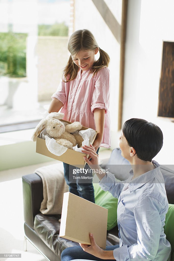 Mother and daughter looking at stuffed animal : Stock Photo