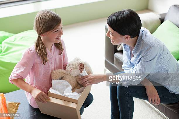 Mother and daughter looking at stuffed animal