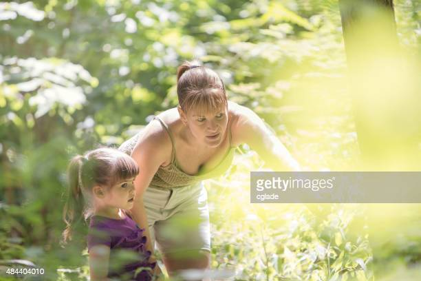 Mother and Daughter Looking for Bugs