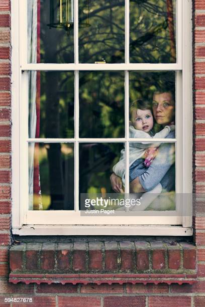 Mother and Daughter Looking Out Sash Window