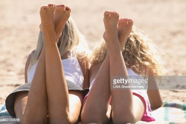 Mother and Daughter Lying Side by Side at Beach