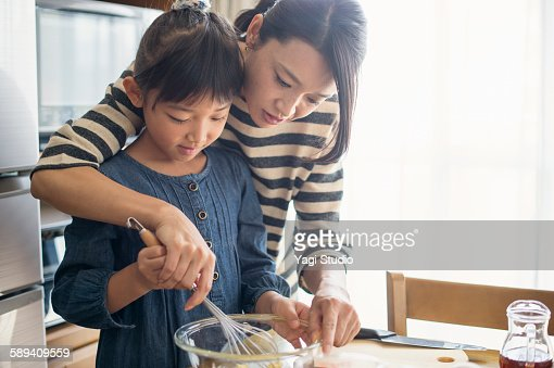 Mother and daughter making  cookies together : Stock Photo