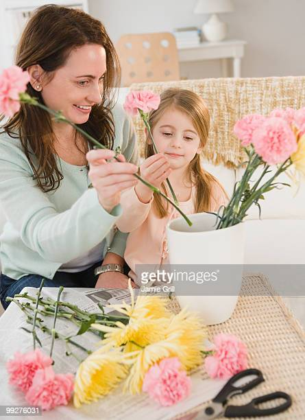 Mother and daughter making flower arrangement