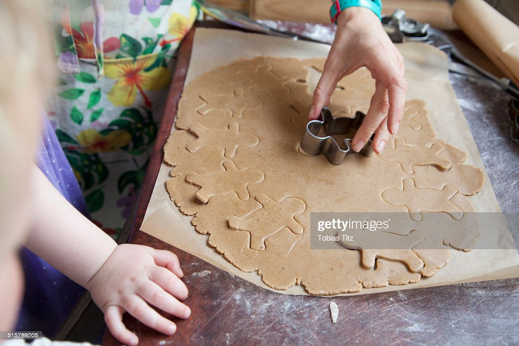 A mother and daughter making gingerbread cookies