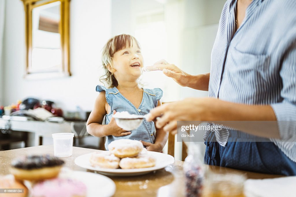 Mother and daughter making sweet donuts in the kitchen : Stock Photo