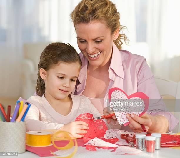 Mother and daughter making Valentines