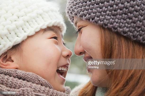 Mother and daughter nose to nose portrait