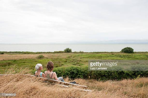 Mother and daughter on a bench