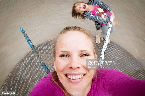 Mother and Daughter on a Merry-go-round