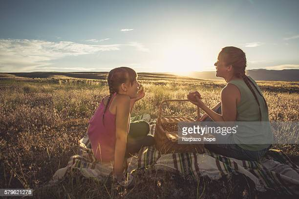 Mother and daughter on a picnic.