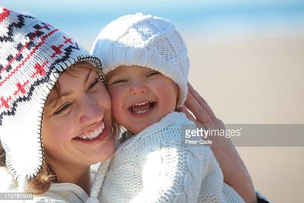Mother and daughter on beach in winter