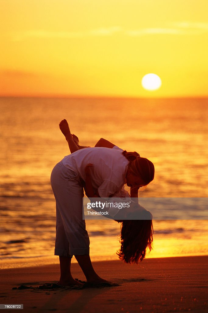 Mother and daughter on beach : Stock Photo