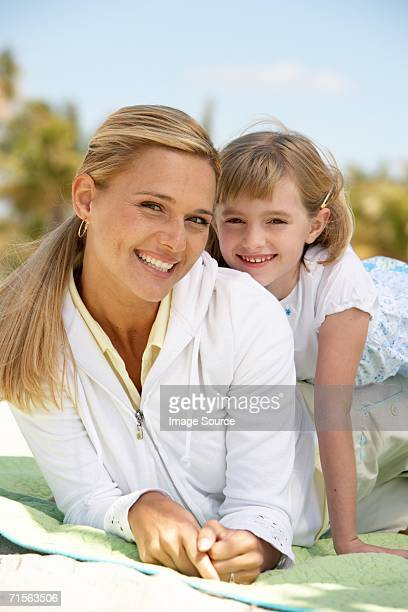 Mother and daughter on blanket