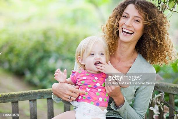 Mother and daughter on chair swing