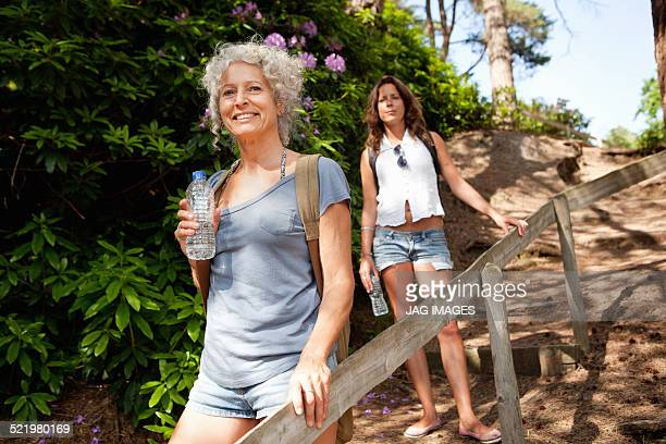Mother and daughter on footpath, The Blue Pool, Wareham, Dorset, United Kingdom