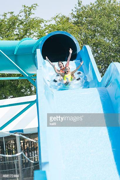 Mother and daughter on giant water slide