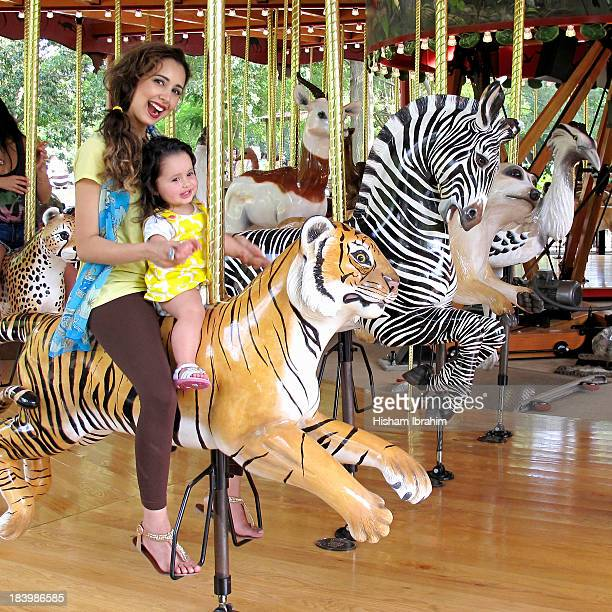 Mother and Daughter on on Merry Go Round Tiger