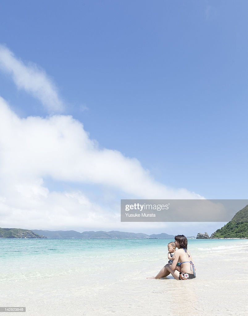 Mother and daughter on the beach : Stock Photo