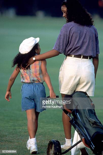 Mother and daughter on the golf course