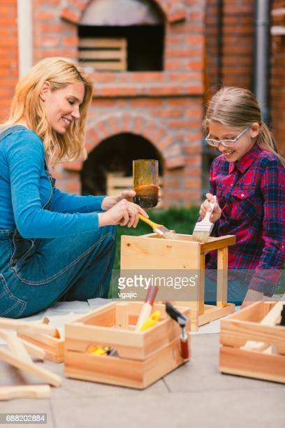 Mother And Daughter Painting chair in Backyard