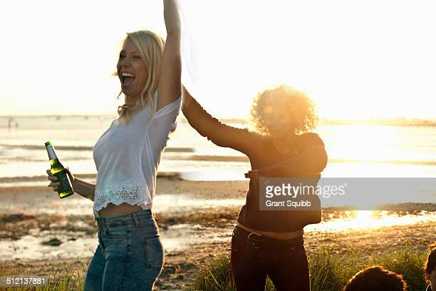 Mother and daughter partying on Bournemouth beach, Dorset, UK