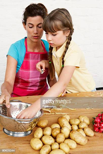 Mother and Daughter Peeling Potatoes