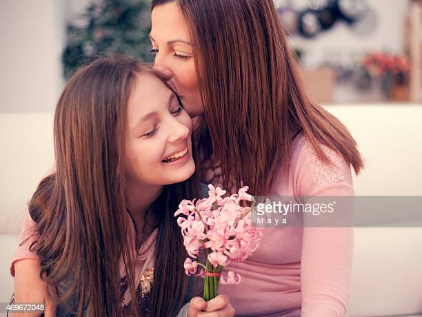 Mother and daughter making out