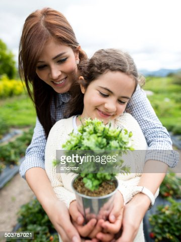 Mother and daughter planting a tree