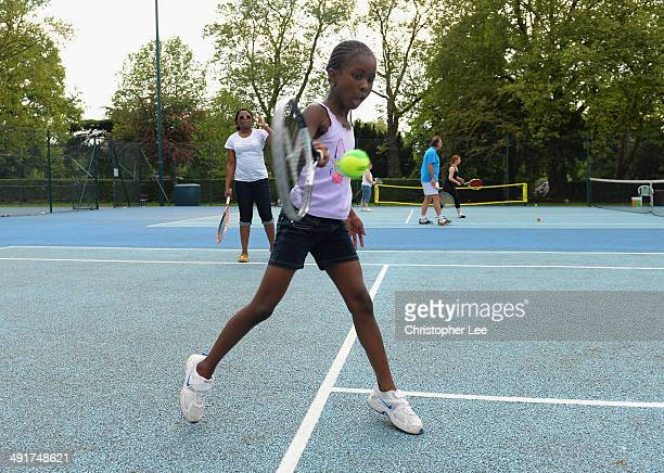 A mother and daughter play doubles together as they get lessons for free during the LTA Great British Tennis Weekend on May 17 2014 in Ealing England