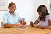 Mother and daughter playing card game together