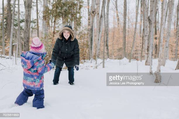 Mother and daughter playing in snow, Peterborough, Ontario